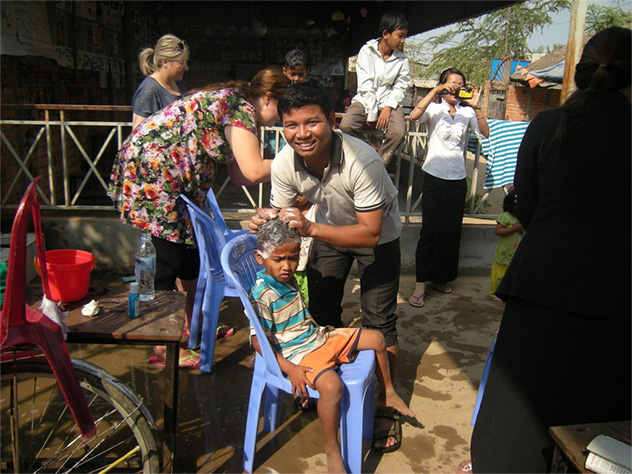 Sophan washing young boy's hair